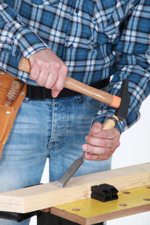 craftsman working on a wooden board Stock Photo - 13582174