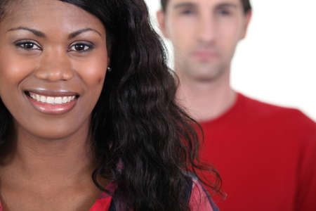 in low spirits: Smiling woman standing in front of a man