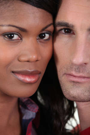interracial love: Couple stood with faces together Stock Photo