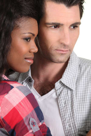 Interracial couple side by side Stock Photo - 13582179