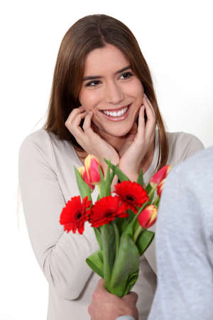 admirer: woman receiving a bouquet