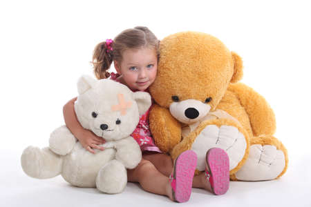Little girl hugging two big teddy bears photo