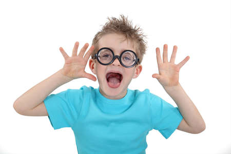 Child wearing wacky glasses and making a silly face photo