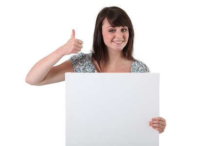 Brunette satisfied with white panel Stock Photo - 13583985