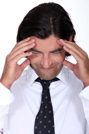 Man with a headache Stock Photo - 13582648