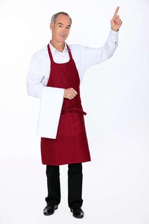 affability: Waiter pointing