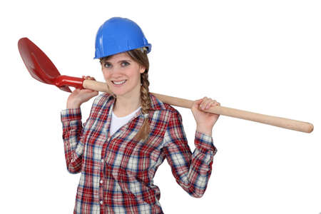 yourselfer: A female construction worker with a shovel