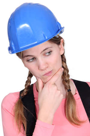 hard look: portrait of female apprentice looking puzzled Stock Photo