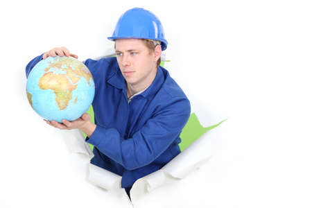 Tradesman holding a globe Stock Photo - 13583743