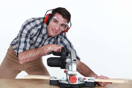 Man using a mitre saw photo
