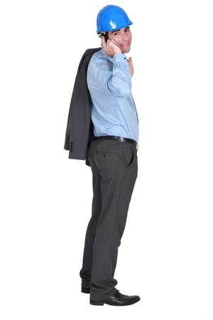 Architect standing on white background photo
