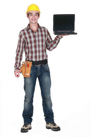 A handyman with a laptop Stock Photo - 13583139