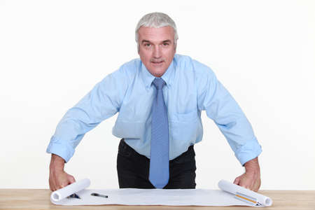 Senior architect looking at blueprints Stock Photo - 13583131