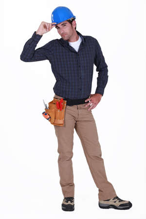 Tradesman giving a salute photo