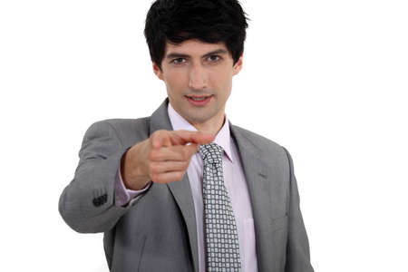 non verbal communication: Businessman pointing his finger
