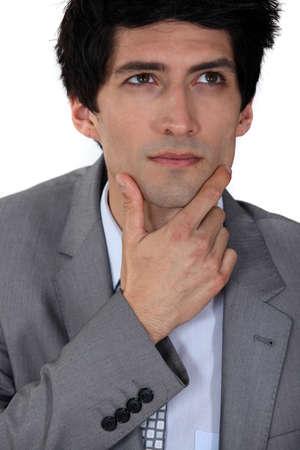 Pensive businessman rubbing his chin Stock Photo - 13581974