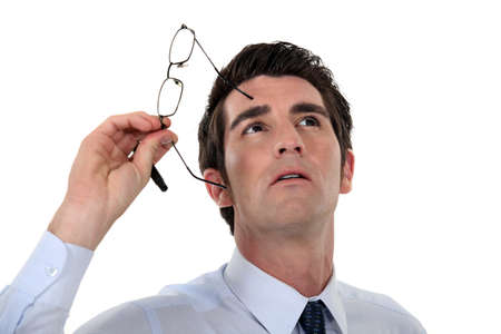 40 45: Man taking his glasses off and looking upwards Stock Photo