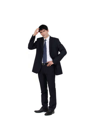 head light: Businessman scratching his head