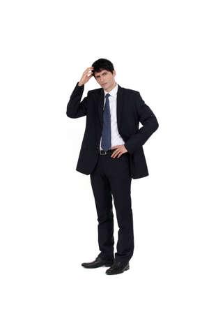 dudas: Empresario rascándose la cabeza Foto de archivo