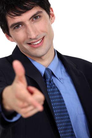 A businessman gesturing a gun shot  photo