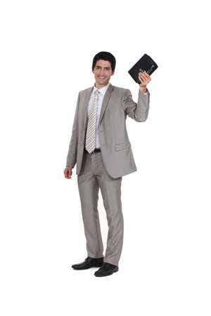 Businessman holding his leather-bound agenda Stock Photo