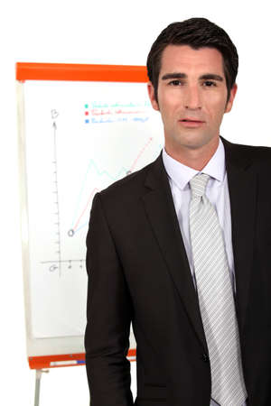 Businessman with a flipchart photo