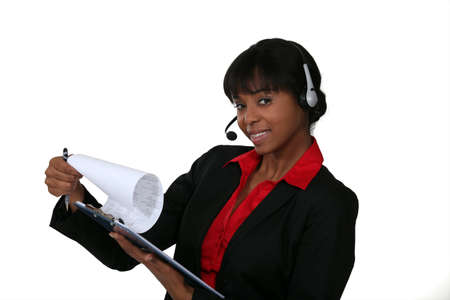 Woman in a headset with a clipboard Stock Photo - 13584486