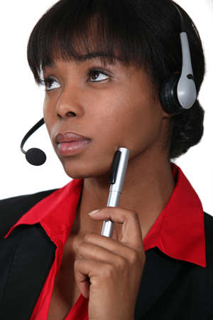 envisage: Afro-American woman wearing a headset Stock Photo