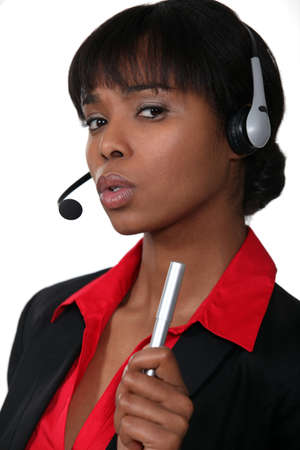 call center agent: Receptionist shaking her pen