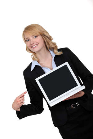 Businesswoman pointing to her laptop Stock Photo - 13583802