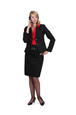 secretary skirt: Pretty blond businesswoman over the phone