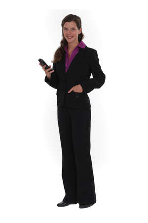 pocket pc: Brunette holding mobile telephone