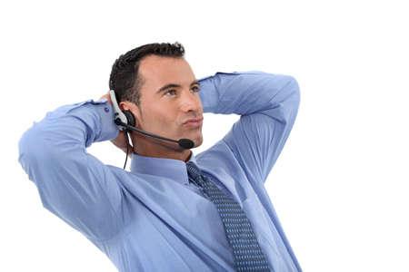 operative: Lazy male call-center operative