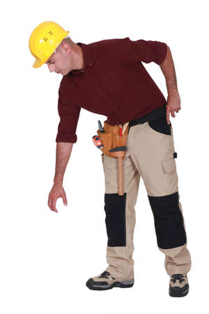 Construction worker reaching down to empty copyspace photo