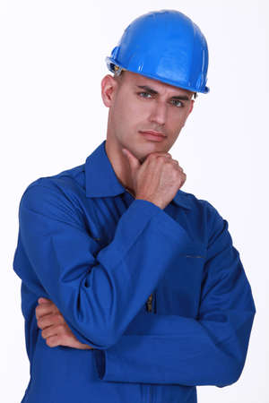 deep thought: Portrait of a pensive tradesman