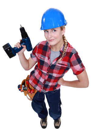 A female construction worker holding a drill  photo