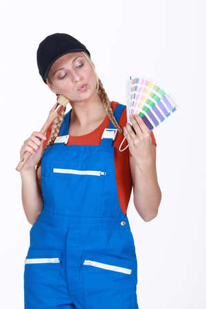 female painter holding color charts Stock Photo - 13582441