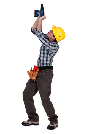 power operated: Tradesman piercing the ceiling