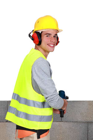 Man drilling into breeze blocks Stock Photo - 13583352