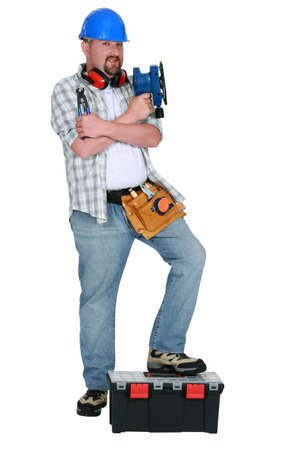 sander: Handyman holding power sander