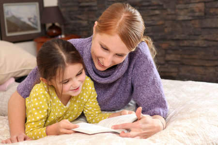 one story: Mother teaching daughter to read