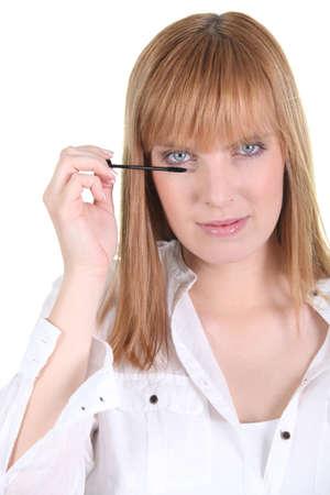 Vrouw toepassing van mascara