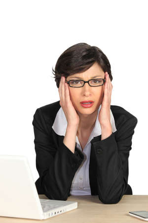 throb: Businesswoman suffering from a headache Stock Photo