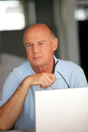 Elderly man using a laptop Stock Photo - 13583446