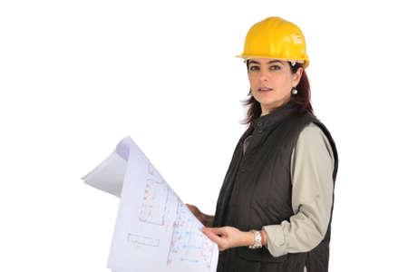 Female architect plans Stock Photo - 13621654