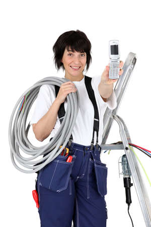 Female plumber isolated on white background photo