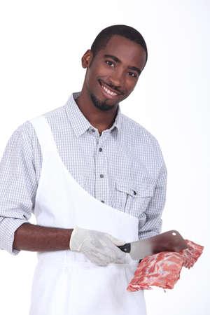 carniceria: Carnicero con un estante de costillas Foto de archivo