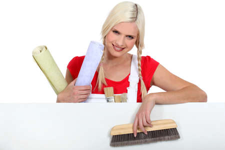 Blond woman with upholstery tools photo