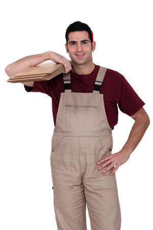 Man ready to fit laminate flooring Stock Photo - 13621950