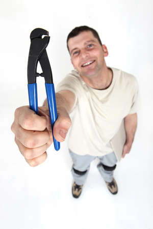 plies: Worker holding clipper Stock Photo